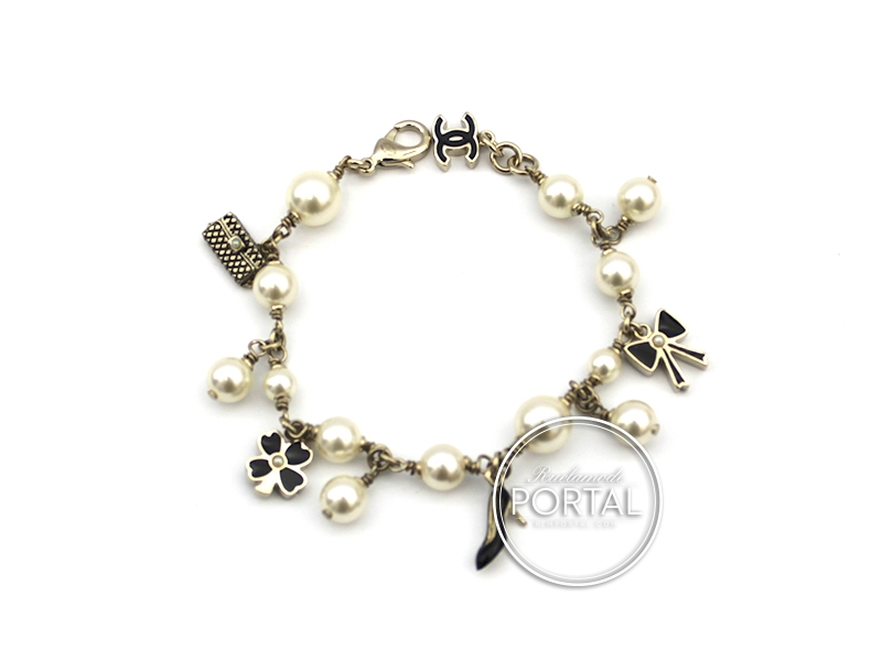 chanel vintage pearl bracelet charms in gold with black enamel